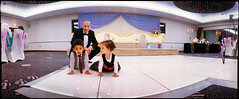 S&H: Rug-rats (*monz*) Tags: panorama color colour film kids groom bride chairs kodak iso400 stage panoramic tuxedo widelux swinglens shaadi tux portra f28 shadi c41 26mm monz panon