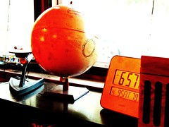 globe and weatherstation in Natchez (Laura Sorrells) Tags: stilllife orange weather mississippi globe vivid natchez stillness weatherstation davidt 2011 funkiness
