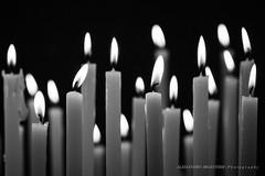 A prayer (Alessandro Argentieri) Tags: blackandwhite bw orange church dark candle prayer religion praying ceremony bn burning flame candlelight spirituality biancoenero preghiera pregare