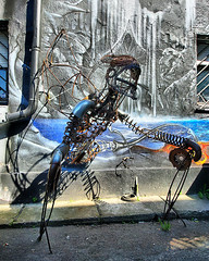 Giger was here (Jumpin'Jack) Tags: street sculpture building monster metal wall standing painting graffiti mural artist alien hans monk creation scifi unknown rudolf creature chariot wireframe giger welded combined witha resembling createdby infrontofa