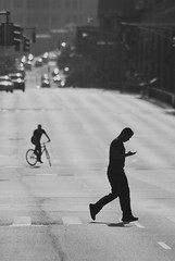 (Vitaliy P.) Tags: road street light shadow sun white man black cars monochrome bike bicycle walking nikon boulevard crossing shadows phone natural no candid cell 300mm queens stepping biking gothamist 70300mm d80 boulevardofdeath midstep vitaliyp