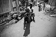 Seithur chronicles (Kals Pics) Tags: life light shadow people blackandwhite india art monochrome bicycle work canon photography blackwhite pov perspective streetphotography wideangle colorless tamilnadu cwc villagelife ruralindia rajapalayam 550d incredibleindia seithur kalspics chennaiweekendclicke