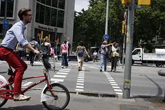 Bicing Red (mikasoikkeli) Tags: barcelona street red bicycle spain poke deutschebank zebracrossing matchingpants bicing