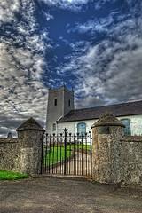 Church - Antrim Coast (robsm) Tags: blue sky cloud white tower church glass cemetery graveyard stone wall nikon gate flickr graves stained northernireland pillars countyantrim antrim robsm