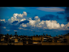 Less time than you think you have (Melissa Maples) Tags: blue sky cinema skyline clouds turkey movie spring nikon asia rooftops widescreen trkiye antalya letterbox nikkor cinematic 169 vr afs  18200mm  f3556g  18200mmf3556g d5100
