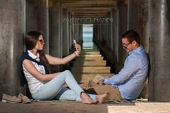 Lorena e Daniele (Marco Nanni) Tags: sea portrait italy sun girl sunglasses marina bay italia mare sole ritratto spiaggia abruzzo ragazza coppia pontile vasto occhialidasole