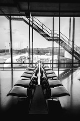 at the airport (FedeSK8) Tags: blackandwhite airport waiting chairs zurich sigma1020mm fedesk8 federicoscotto nikond7000