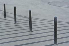 Four poles (Jan van der Wolf) Tags: monochrome lines stripes parking curves curve parkeerplaats lijnen lijnenspel monochroom playoflines interplayoflines map152187v