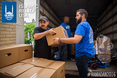 Islamic Relief USA's staff and volunteers take out the Ramadan food boxes from the truck at Dar Al Hijrah in Virginia.