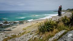Howell's Point/Taramea (Kathrin & Stefan) Tags: ocean newzealand sky cloud plant beach nature rock bay outdoor wave lookout southisland tasmansea flax riverton foveauxstrait oraka colacbay kathrinmarks stefanmarks raka