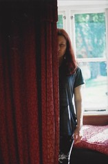 Half the Girl I Used to Be (Film by Emily) Tags: selfportrait girl redhair indoors inside curtrain half colour film light window concept canonae1 depthoffield emilyjacksonfilm portrait person bokeh