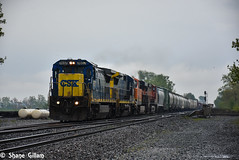 Standard cabs playing in the rain. (Machme92) Tags: railroad ohio rain clouds nikon tracks rail trains row rails ge railfan freight bnsf railroads csx conrail emd railfanning csxt railfans trainrace nikond7200