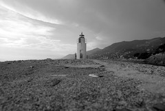 Faro (lighthouse) (pjarc) Tags: camera travel sea bw italy costa lighthouse white black june rock digital port lens faro coast photo nikon holidays europa europe italia mare foto zoom liguria digitale porto d200 nikkor giugno roccia lente camogli biancoenero dx 2016 18200mm allaperto nofullframe