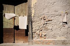 Typical Sicilian house facade with laundry hanging in Santa Maria la Scala - Sicily (PascalBo) Tags: nikon d300 europe italia italie italy sicily sicilia sicile santamarialascala acireale door porte architecture street rue wall mur pascalboegli outdoors outdoor