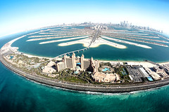 palm jumeirah - dubai (Emmanuel Catteau photography) Tags: travel sea building tower tourism beach water pool marina project wonder landscape hotel persian sand holidays dubai photographer gulf united reporter artificial aerial palm fisheye atlantis emirates helicopter national arab journey villa planet conde lonely arabian marvel geo geographic nast jumeirah traveler catteau wwwemmanuelcatteaucom