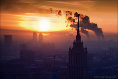 not my photo (Micaella McElmurry:)) Tags: roof winter sunset two chimney sky urban sun sunlight building industry church fog skyline architecture outdoors town smog construction energy factory cityscape technology exterior russia moscow district smoke air pipe cities dramatic environmental scene aerial steam gas pollution damage environment generation warming fuel fume fumes