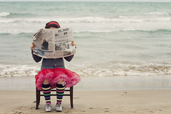 4/12. Peridico-Newspaper (Isabel Pava) Tags: sea girl kids bench children fun newspaper spain child getty claudia gettyimages elpas chidhood gettyimagesiberiaportrait