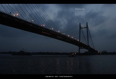 Twilight Saga#1 : Vidyasagar Setu (Anindya Roy Photography) Tags: bridge india canon twilight kolkata ganges westbengal vidyasagarsetu secondhooghlybridge paschimbanga prisepghat