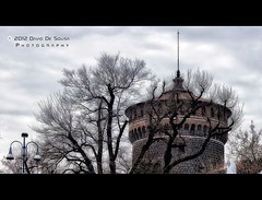The Castle's Tower (Far & Away (On assigment, mostly off)) Tags: winter italy milan cold tower castle history europe branch wave medieval leafless emptyness