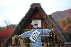 Welcome! (Elios.k) Tags: horizontal outdoors nopeople scarecrow hayman field hay peacesign sign fingers house traditional ochudo cafe depthoffield dof shallow focus focusinforeground backgroundblur colour color sugegasa hat conical straw asian japanese expression facial mountain background sky travel travelling november 2015 vacation canon 5dmkii camera photography gasshzukuri gassho style farmhouse architecture thatched roof unesco worldheritagesite village ogimachi shirakawago shirakawagoarea shirakawag gifuprefecture onodistrict no chbu chubu honsu asia japan