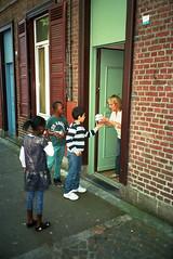 (michel nguie) Tags: michelnguie film analog vertical street urban city roubaix rbx kids boys girls children ball football granny windows door people redbricks