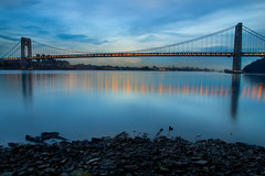 Sleepy Hudson (SunnyDazzled) Tags: newyorkcity longexposure bridge newyork reflection water river landscape lights evening newjersey lowlight cityscape shore hudson georgewashington suspensionbridge fortlee georgewashingtonbridge