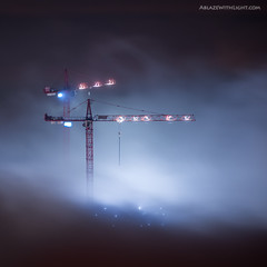 Cranes from Hell (Sebastian Opitz) Tags: above rooftop fog skyline architecture clouds downtown dubai cityscape skyscrapers surreal aerial unreal