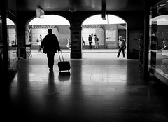 leaving town (nicolasheinzelmann) Tags: bw silhouette schweiz switzerland fuji fujifilm bern schwarzweiss koffer x10 laube reisende gepck lauben fujifilmx10 fujinonasphericallens nicolasheinzelmann fujix10 30april2012