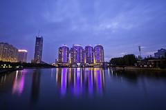 Xibei Hu (Northwest Lake) at Dusk  (olvwu | ) Tags: china city longexposure light sky lake reflection building skyline night dusk wuhan hubei magicmoment jungpangwu oliverwu oliverjpwu wuhancity olvwu hubeiprovince jungpang xibeihu xibeilake