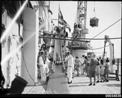 Children on a slippery slide on board HMAS CANBERRA, 12 December 1931 (Australian National Maritime Museum on The Commons) Tags: ship christmasparty sunk ran cruiser sydneyharbour warship gardenisland d33 hmascanberra royalaustraliannavy childrenschristmasparty australiannavy harbourscenes navalvessel countyclass battleofsavoisland hmascanberrad33 samueljhoodcollection captainfarquharsmith navalchristmasparty commodoreholbrook