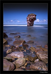 Thorntonloch Rock 2 (Dougie Williams) Tags: longexposure blue beach landscape scotland landscapes edinburgh seascapes horizon lee stacking stopper eastlothian longexposures torness bythesea dunglass thorntonloch bigstopper leebigstopper landscapephotographymagazine musselburghcameraclub