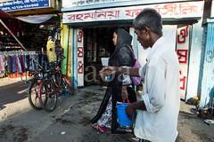 H504_3221 (bandashing) Tags: street england people woman man manchester hands shops layers bags sylhet bangladesh carry socialdocumentary superimposed aoa bondor bandashing akhtarowaisahmed bondorpoint