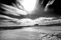 Castle Bamburgh, Northumberland (Silent Eagle  Photography) Tags: longexposure sea sky bw sun seascape reflection beach monochrome beautiful weather clouds canon yahoo google focus rocks silent eagle lee sep northeast bamburgh brillant bamburghcastle 40sec leefilters canoneos5dmarkiii silenteaglephotography silenteagle09