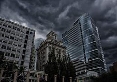 Storm's a'brewin' (Ken Cruz --- Fernweh) Tags: skyline architecture oregon photoshop buildings portland gloomy skyscrapers cloudy clocktower nik pioneerplace