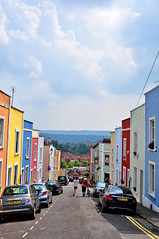 Colour Terrace (Reuben Hastings) Tags: road city pink blue houses red summer england urban orange white black colour art lines yellow architecture contrast buildings bristol view bright terrace horizon distance clifton cliftonwood