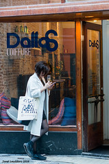 Champagne and Phone is all you need (Streetphotography by Joost Smulders) Tags: city people urban woman holland color colour amsterdam store phone candid champagne nederland streetphotography winkel vrouw stad warmoesstraat mensen kleur straatfotografie