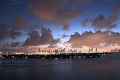 Miami Sunset Late Blue (Sacker Foto) Tags: city sunset urban reflection water colors clouds landscape photography lights bay colorful exposure bright florida kitlens wideangle reflect nightphoto bluehour miamibeach puffy settingsun upscale starisland orangeglow dadecounty canon60d sackerfoto canon18135mmf3556