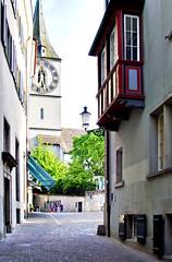 Zurich Old City (Artur Staszewski) Tags: street old city tower clock architecture canon buildings switzerland town swiss zurich culture sigma tourist calm german quite popular narrow attraction visited 550d 1770mm t2i