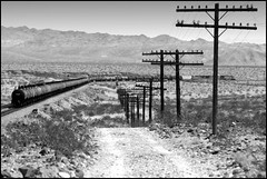 Empty Ethanol and the Code Line (L-R) (greenthumb_38) Tags: california railroad blackandwhite bw train blackwhite route66 mojave duotone locomotive bnsf mojavedesert thecut motherroad sanbernardinocounty railroading desertlife nationaltrails rte66 themotherroad nationaltrailshighway ashhill needlessub jeffreybass natltrailshwy ludlowadventure2012 thecutatashhill