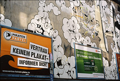 A wall in Kln / Cologne (Germany): Election campaign (wwwuppertal) Tags: film wall germany advertising poster deutschland graffiti mural wand cologne kln db billboard nrw deutschebahn werbung nikonfe analogphotography plakat nordrheinwestfalen rheinland reklame wandbild wandmalerei electioncampaign landtagswahl wahlwerbung wahlplakat northrhinewestphalia analogefotografie analoguephotography piratenpartei kostrom greenelectricity kodakektar100 nikonseriese1850mm vorgezogeneneuwahlen nikonserieselens50mm118