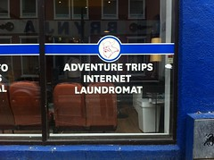 Viking. Adventure Trips. Internet. Laundromat. (alykat) Tags: window sign iceland reykjavik viking iphone iphone4