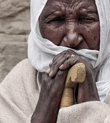 """And Sarah saw the son of Hagar"" (ybiberman) Tags: portrait woman easter israel eyes veil jerusalem hijab walkingstick oldcity alquds ethiopian legswashingceremony"