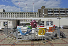 worthing lido (maximorgana) Tags: building cup window shop fence jack worthing tea flag union go round teapot merry merrygoround lido