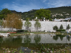 Commonwealth Park Gibraltar (Tolledot) Tags: park blue trees sky lake nature water rock stone pond stones walls