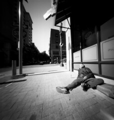 Asleep in the sun (Zeb Andrews) Tags: street urban bw 6x6 film contrast mediumformat portland blackwhite downtown pinhole pdx asleep lensless lightshadow analogphotography fomapan100 directsunlight realitysosubtle6x6