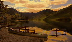 Tranquility (Paul.Coote) Tags: trees light sky cloud mountain lake plant colour reflection nature water landscape outdoor lakedistrict canoe haystacks cumbria summit fell mountainridge