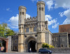 Abbot Fyndon's Great Gate, 1297-1309, St Augustine's Abbey, Canterbury, Kent, England (edk7) Tags: nikond610 nikonafnikkor28105mm13545d edk7 2015 uk england kent canterbury staugustinesabbey abbotfyndonsgreatgate12971309 gradeilisted medieval perpendicular english gothic church architecture building oldstructure sculpture statue stonecarving unescoworldheritagesite tree cloud sky house car tower column lancet window crenelations monastery