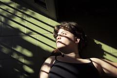 mil y un veranos (Nowhere land) Tags: girl chica mujer woman floor suelo light luz shadows sombras rejas mirada look bars portrait retrato selfportrait autorretrato