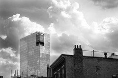 clouds over lower Manhattan (petespande) Tags: nyc newyorkcity bw newyork skyline architecture clouds buildings downtown manhattan streetphotography tribeca sigma105mm28 buildingsofnyc