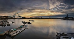 Wangkung fishing port  (Vincent_Ting) Tags: sunset sea sky panorama reflection taiwan wharf    cloudscape  archbridge fishingport    vincentting